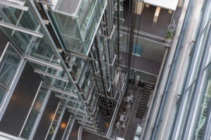 Looking down elevator shaft of a modern office building