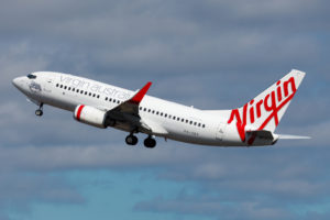 Virgin airplane taking off from airport